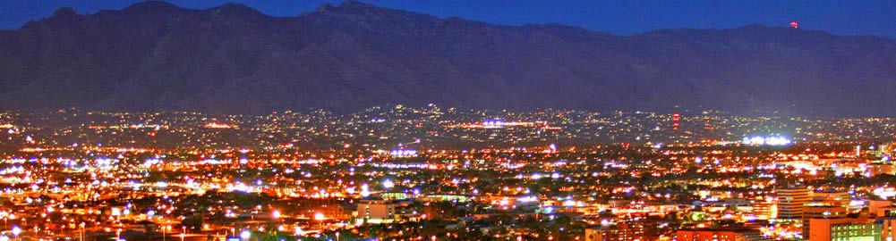 Duffy Electric with Tucson Skyline at Night